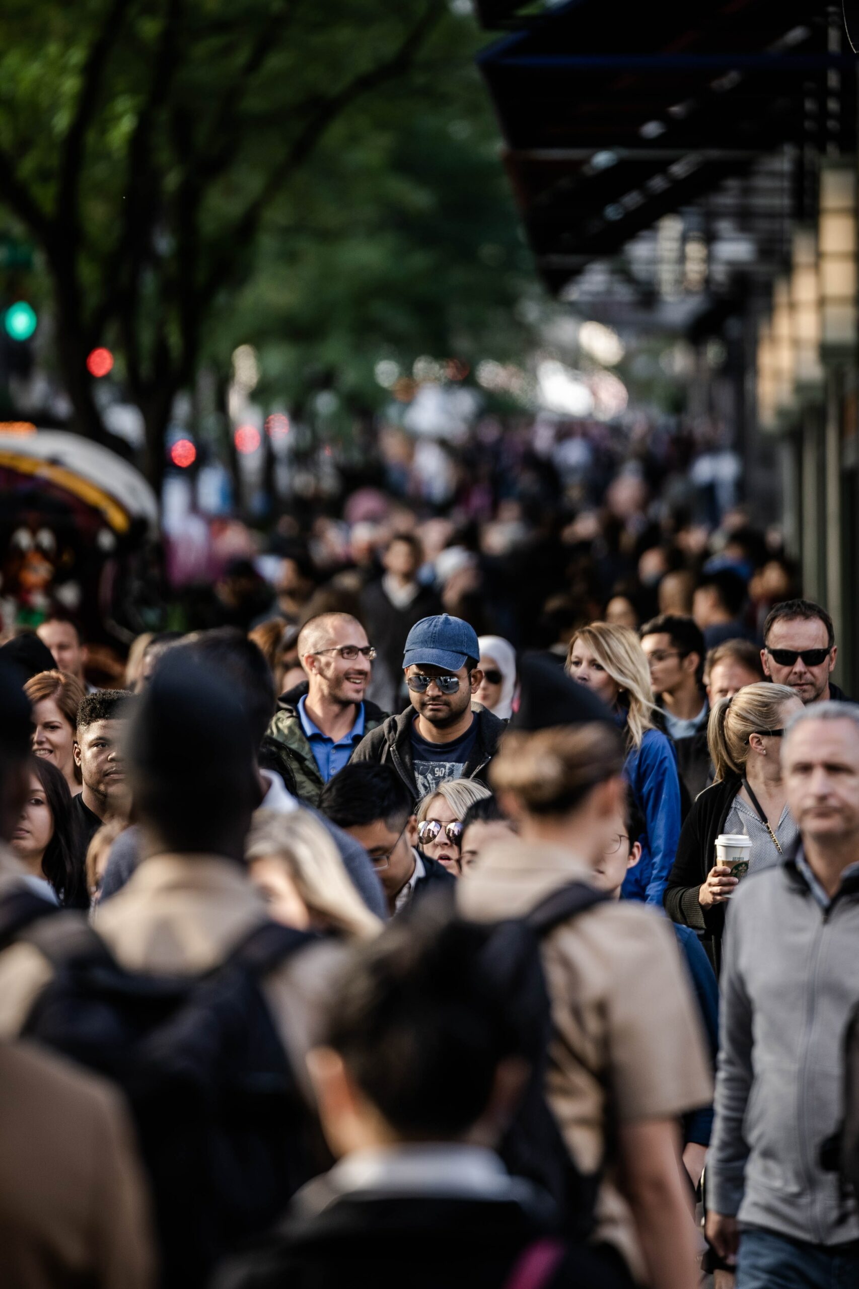Man in large crowd of people outside